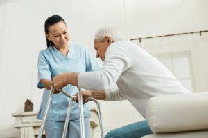 oyful nice woman helping an elderly man