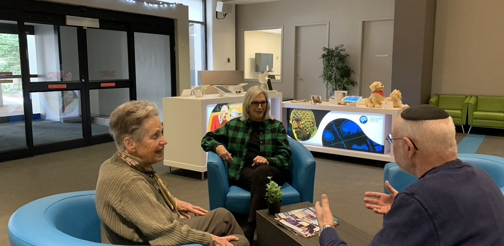 Older adults from CABHI's Seniors Advisory Panel talking to each other.
