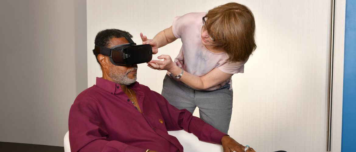 Project lead Lisa Sokoloff demonstrates Virtual Reality (VR) Dementia Simulation (Baycrest). Her innovation was selected for the Early Adoption Initiative.
