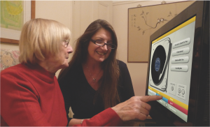 Older adult woman, and younger woman looking at a screen