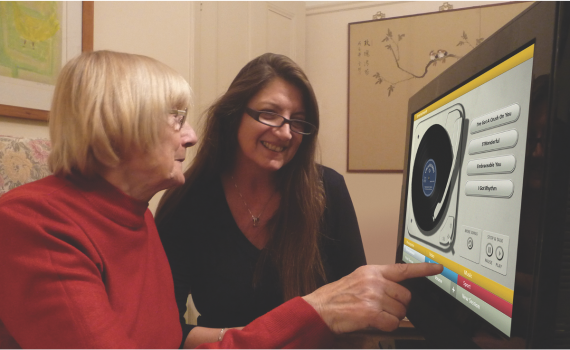 Senior woman and young woman looking at a computer screen