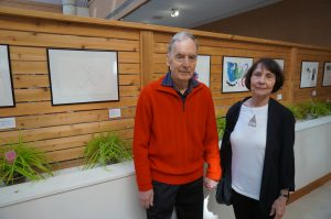 A picture of Diane, who's interviewed, and her husband at the art exhibit held at Baycrest