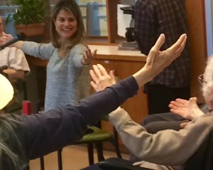 A picture of dance instructor Annie Raphael interacts with seniors during filming of the e-module.