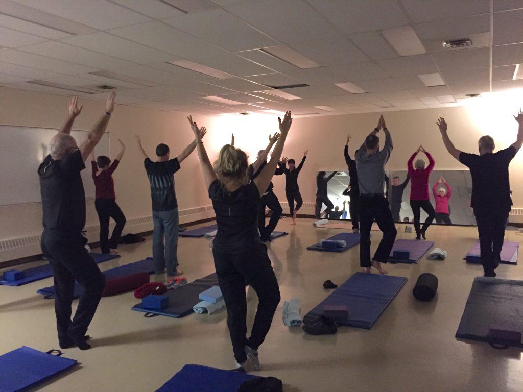 YouQuest participants doing group yoga