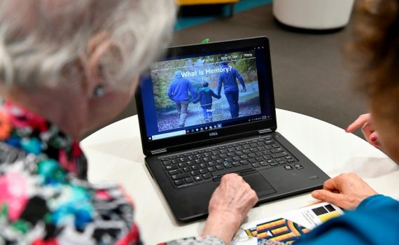Older adults looking over health information at a laptop