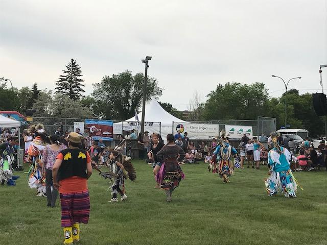 Indigenous Pow Wow on a green Field.