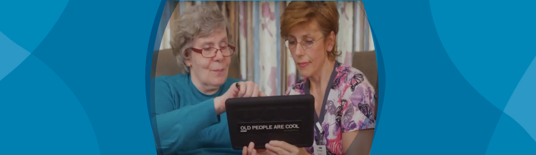 Caregiver and Senior using a tablet