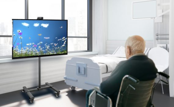 An older adult watches the MindfulGarden Platform