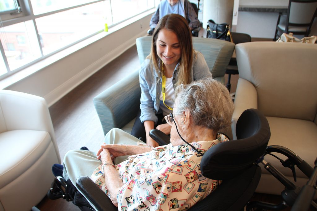 PLEASE volunteer Sabrina Teles interacts with a resident.