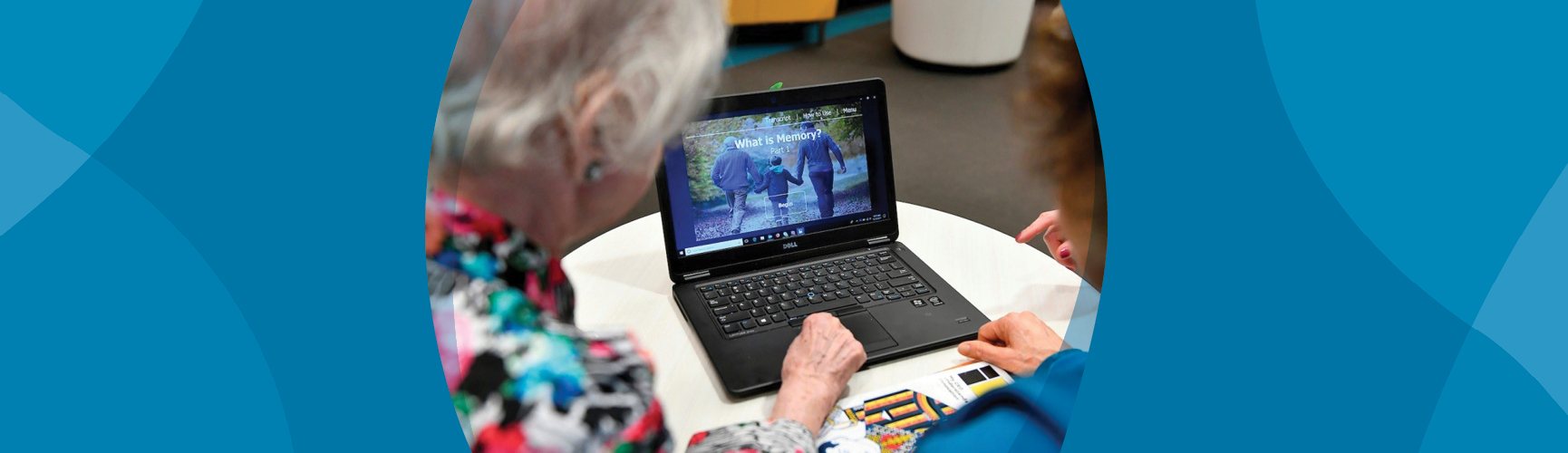 Older adults look at health information on a laptop