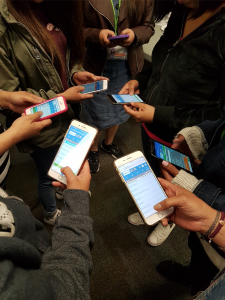 Six people are pictured engaging with the SOS app.