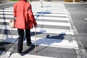 A woman crossing the street