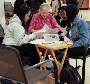 Students and seniors spend time together as part of the Zeitgeist project