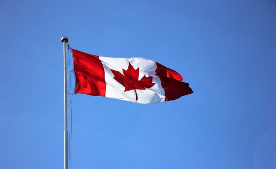 Canadian flag floating in the wind.