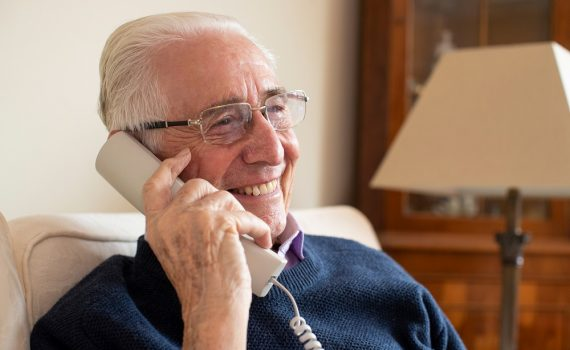 Older adult man on the phone.