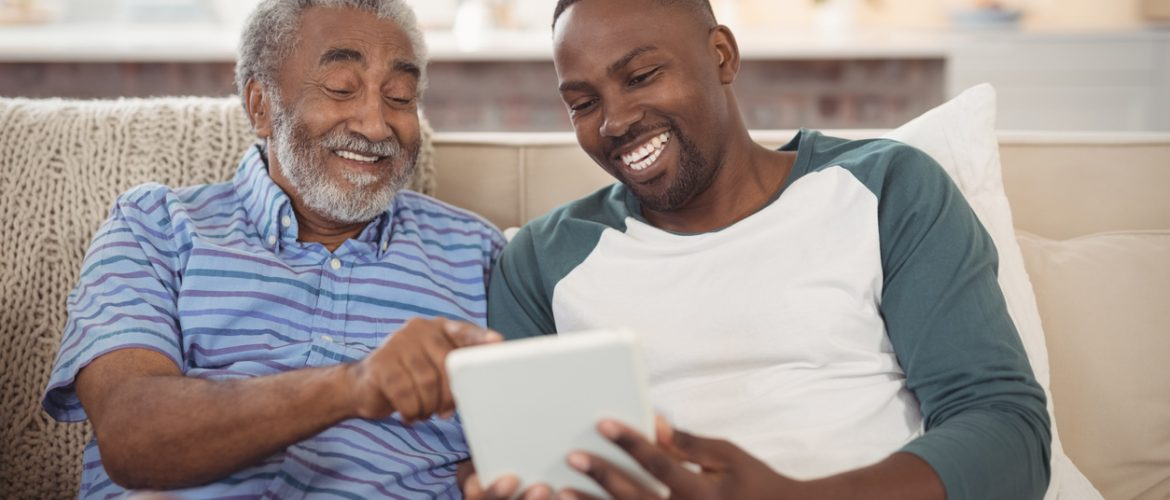 Two men using a tablet