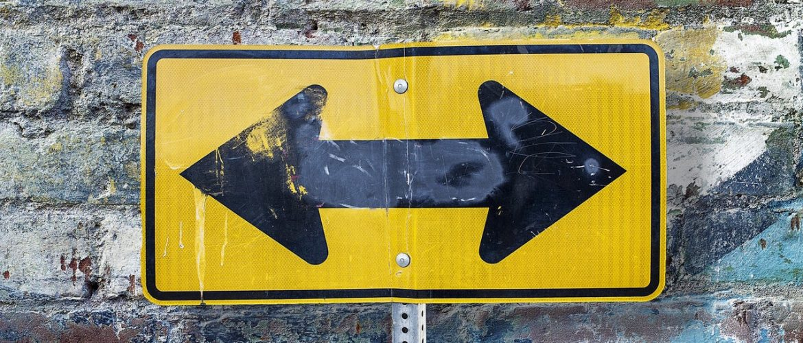 Road sign with arrows pointing in multiple directions