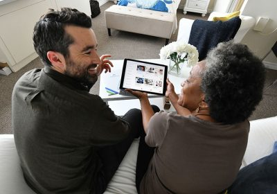 Image of two people looking at tablet